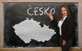 Teacher Showing Map Of Czech On Blackboard