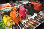 stock photo of exposition  - Shop window with female handbags and shoes - JPG