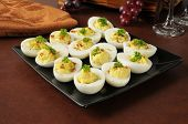 stock photo of yoke  - Egg salad stuffed in the eggs and sprinkled with paprika - JPG