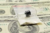 image of crystal meth  - syringe with a drug is on the money with white powder - JPG