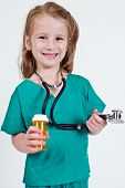 Young Caucasian girl playing doctor