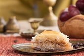 picture of phyllo dough  - Delicious baklava dessert in oriental golden setting - JPG