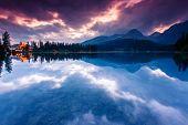 Mountain lake in National Park High Tatra. Dramatic overcast sky. Strbske pleso, Slovakia, Europe. B