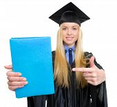 Closeup On Young Woman In Graduation Gown Pointing On Book