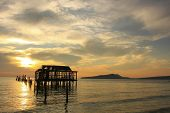 Silhouette Of Old Wooden Jetty At Sunrise, Koh Rong Island, Cambodia