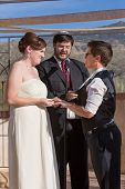 foto of rabbi  - Cute lesbian couple in civil union with Jewish Rabbi - JPG