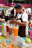 Thai Man Selling Fresh Juice At Market