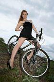 Sexy Blonde On The Bike