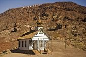 Calico Church With Sign On The Mountain