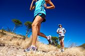 foto of leaping  - marathon running athletes couple training on trail fitness sport active lifestyle - JPG