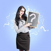 picture of life after death  - Ghostly business woman asking question on life insurance after death while holding a question mark chalk board on blue background - JPG