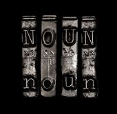 picture of nouns  - Noun word in metal type on black background - JPG