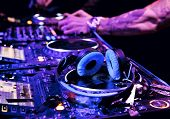stock photo of disc jockey  - Dj mixes the track in nightclub at party - JPG