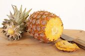 Ripe Pineapple On Cutting Board