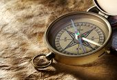 stock photo of compass  - Vintage compass on paper background - JPG
