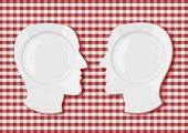 Two head plates face to face on red picnic tablecloth