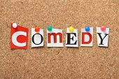 stock photo of comedy  - The word Comedy in cut out magazine letters pinned to a cork notice board - JPG