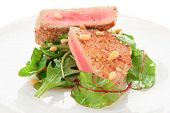 Lightly seared tuna steak with sesame and fresh salad