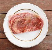Premium quality ribeye steak, oiled and peppered