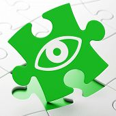 Privacy concept: Eye on puzzle background