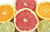 Background Of Cut Grapefruit, Orange And Lime.