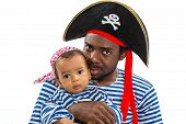 African American Child Boy And Father In Costume Pirate On White Background. Baby Halloween Fancy Co