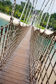 Suspension footbridge over the sea on the island of Sentosa in Singapore.