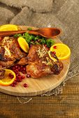 Roasted quails  on cutting board, on sackcloth, on wooden table background