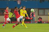 VIENNA,  AUSTRIA - JUNE  7 David Alaba (#8 Austria), and Kim Kaellstroem (#9 Sweden) fight for the b