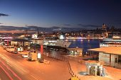 ISTANBUL, TURKEY - OCTOBER 20, 2010: Ferry boat quay in the Golden Horn bay in evening. Ferry is fas