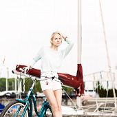 Beautiful Girl With City Bike At Sea Pier