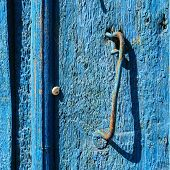 blue door and handle