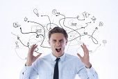 Angry businessman shouting against brainstorm doodle with arrows