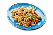 cold pasta salad with pachino olives zucchins and pine kernel