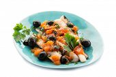 fish fillet with tomatoes black olives and pepper