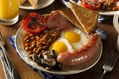 picture of yolk  - Traditional Full English Breakfast with Eggs Bacon Sausage and Baked Beans