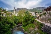 Old Town Of Mostar. Islamic Architecture With River Running Through City.