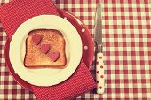 Retro Vintage Style Red Check Table Setting With Polka Dot Plate And Knife And Toast With Hearts For