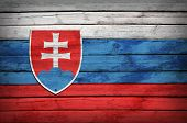 Slovak flag painted on wooden boards