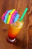 Red, Yellow Cocktail With Lemon, Straw, Umbrella Deco