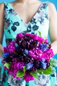 Bridesmaid Holds A Wedding Bouquet Of Tulips And Pions In Purple Tones