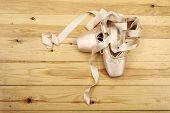 foto of ballet shoes  - pair of ballet shoes pointes with ribbons on wooden floor - JPG