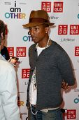 NEW YORK-APR 28: Singer Pharrell Williams attends the Pharrell Williams UNIQLO 'I Am Other' Collecti