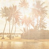 Grunge style photo of beautiful tropical beach, palm trees in bright sun light, exotic nature, summer holiday and vacation concept