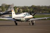 Beechcraft A36 Bonanza business aircraft running on the runway