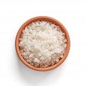 Sea salt in bowl on white background