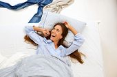 Portrait Of A Smiling Woman Awake In Bed