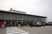 BOLOGNA, ITALY - APRIL 19, 2014: Travellers stand outside an Autogrill S.p.A restaurant and mini market in Bologna, Italy, on Saturday, April 19, 2014.