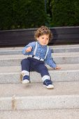 pic of descending  - Toddler boy trying to descend stairs on the bottom - JPG