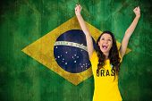 picture of excite  - Excited football fan in brasil tshirt against brazil flag in grunge effect - JPG